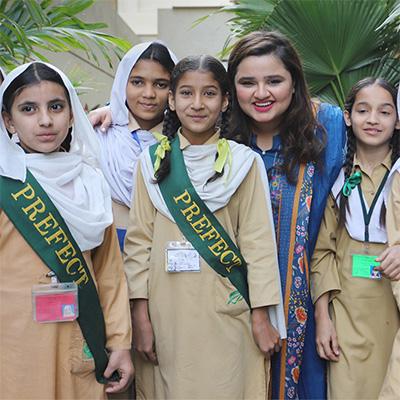 Photo of Faiza Saleem with TCF students
